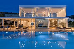 Sitting atop a rocky steep slope on the Coast of Aegina Island this stunning villa uses its raised position to bring out magnanimous views on the Sardonic Gulf. Luxury Villas In Greece, Modern House Design, Coast, Island, Mansions, House Styles, Artwork, Home, Work Of Art