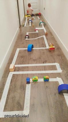DIY Race car track using tape- bubby would love this in our hallway!