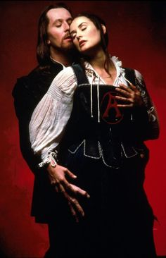 The Scarlet Letter - Demi Moore as Hesther Prynne wearing a white cotton blouse, blue skirt and black corset with white trims and the infamous scarlet A.    The costumes were designed by Gabriella Pescucci and made by Tirelli Costumi.