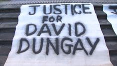 A banner on the steps of the Downing Centre.