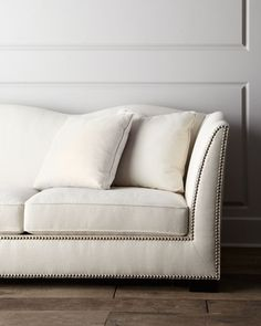 """Sofa made of select hardwoods with polyester/linen upholstery. Studded trim. Scalloped back. Includes six matching accent pillows covered in polyester/linen and rayon/linen blend fabric. 110""""W x 41""""D"""