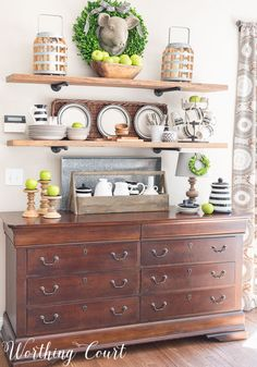 Open rustic farmhouse kitchen shelves decorated for late summer