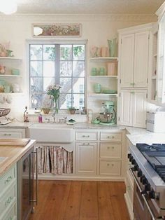pretty vintage kitchen. Green knobs.