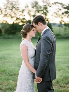 bride and groom embrace during a virginia sunset - fuji 400h - captured by Jordan Baker Photography at wolf trap farms - Gordonsville, Virginia