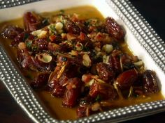 Roasted Dates with Pancetta, Almonds and Chile from FoodNetwork.com  These Rock they come out tasting sweet and savory!