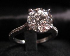 Round Solitaire Engagement Ring with Pave Band...someone be so kind to let my future husband know this is exactly what I want.