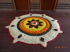 60 Most Beautiful Pookalam Designs for Onam Festival Rangoli Designs Flower, Rangoli Patterns, Colorful Rangoli Designs, Flower Rangoli, Rangoli Ideas, Rangoli Designs Images, Rangoli Designs Diwali, Diwali Rangoli, Beautiful Rangoli Designs