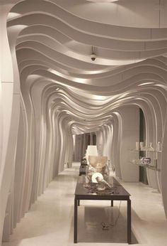Italian design studio CLS Architetti have completed a shop in Vietnam with undulating fins and a giant mirrorball. Retail Interior, Home Interior, Interior Architecture, Interior Design, Modern Interior, Spa Design, Cafe Design, Karton Design, Colani