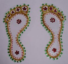 """""""Kundan Laxmi Paadas"""" is one set of nicely decorated with kundan art piece. These can be kept in your altar on special occasions, which gives very special look. These paadas are 13Cms in length and 6 wide. These Paadas are decorated with special green and pink kundans that gives elegant look to your altar. https://www.facebook.com/AishwaryaArtsnCrafts"""