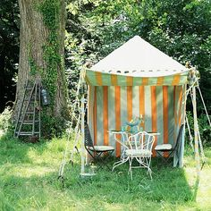 Garden tent dining area. FURNITURE Tea tent, Raj Tent ClubWhite metal garden table, LibertyAntique chairs, AntiquatedFABRICChair fabric, Mulberry ACCESSORIESTurquoise glass cake stand, LibertyGreen and blue glass tumblers, Cath Kidston