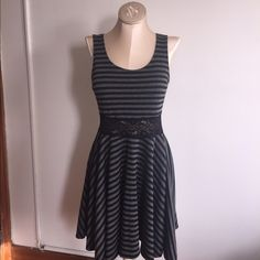 Black and gray striped dress Black and gray striped wet seal dress with lace on the waist. Juniors large fit and flare flattering for ALL shapes Wet Seal Dresses Mini