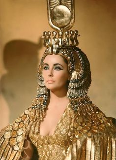 she looks stunning as Cleopatra and what an outrageous headpiece and costume