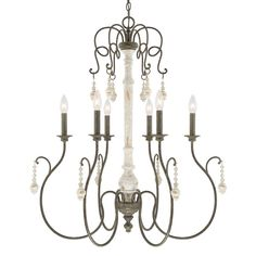 This 10-light chandelier from the Vineyard collection features a beautifully hand painted French Country finish that will complement many traditional decors. The perfect contrast of the column, arms a