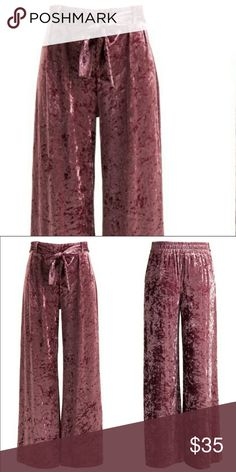 "💐Mauve Crushed Velvet Wide Leg Pants! Mauve Crushed Velvet Wide Leg Pants! These wine colored velvet are perfect for the holiday season. They feature a front tie accent, pair them with your favorite pair of shoes and top for a trendy look, true to fit sizes S, M, L, inseam measures 30"" - 32"", waist flat lay measurement is 12.5"" - 14.5"". Pants Wide Leg"