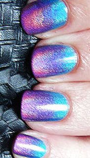 The polishes are all China Glaze Holographic polishes from the OMG! Collection (2008). The colors are DV8, LOL, and BFF.