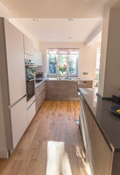 From German handleless kitchens to bespoke painted in-frame kitchens, browse our ranges and pick your style. Kitchen In, Kitchen Cabinets, Handleless Kitchen, Moonlight, Corner Desk, Grey, Furniture, Home Decor, Fashion