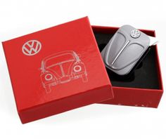 Beetle Lighter-Silver. A high quality lighter with a design based on the original vw beetle. Product Features:  Beetle Bonnet Front Plate Design Matching Single Colour Rear Plate Metal Lighter Enamel Finish Butane Gas ElectronicRefillable Lighter Comes in a Red Presentation Gift Box Instructions & Guarantee Officially Licensed by VW  Product Dimensions (Approx):  Lighter size: 5cm(L) x 3.5cm(W) x 1.2cm(D) Presentation Box Size: 8.5cm(L) x 8.5cm(W) x…