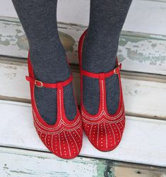 T-strap, cute design, rich color. - would be so easy to diy these from a solid colored pair with some metallic fabric paint or tiny rhinestones