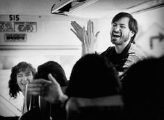 steve jobs w/ employees on a bus in 1987