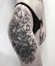 Black dot-work flowers thigh tattoo. More