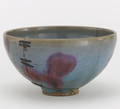 Bowl ( Jun ware) 1279-1368. Yuan dynasty. Stoneware with Jun glaze and copper pigment; repaired with metal staples HxW: 8.5 x 15.3 cm. China. Gift of Charles Lang Freer.]