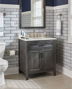 Install an updated bathroom vanity for a small change that makes a big difference. This neutral gray vanity designed by Jonathan and Drew Scott is a stylish, new favorite.