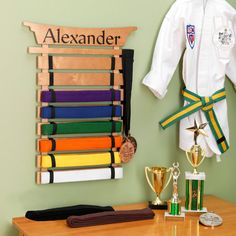Martial Arts Belt Display Holder for Taylor. At the rate he's learning, I'd say he will have enough belts that he can get one by his birthday! ^_^