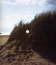 Nancy Holt, Views Through a Sand Dune, Narragansett Beach, Rhode Island, 1972
