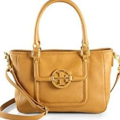 110% AUTHENTIC Tory Burch Amanda double zip bag Guaranteed authentic!This style is no longer in rotation-purchased in Copley Sq Boston store in spring 2013.Great condition except small pen marks in interior.Adjustable/detachable shoulder/Crossbody bag.Wear without strap on your forearm as a classy satchel,or wear over shoulder as a modern tote bag, or wear it across your body for a more casual and effortless look.Each side of bag also has a horizontal zipper for extra storage.Serious offers…