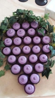 How cute is this? Grape cupcakes for a wine-themed birthday party!