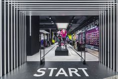 Start at the door with a large graphic on the floor to impress customers from the very beginning.: Start at the door with a large graphic on the floor to impress customers from the very beginning.
