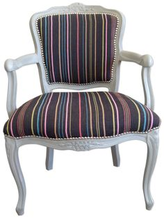 Fun Stripe Carver Chair - IKEA - 2014 - Blue Multi Stripe Fabric  This tired old carver chair was stripped back to the frame. The chair was then painted using Annie Sloan Chalk Paint in Paris Grey and finished with the Annie Sloan clear wax.  The chair was fully reupholstered and then covered in this lovely IKEA fabric which is funky and vibrant! The chrome studs give a nod to it's past but bring it right up to date.
