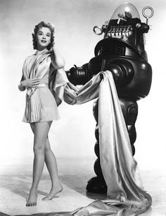 Classic Sci-Fi Movies: Forbidden Planet Robby the Robot & Altaira (Anne Francis) Cultura Pop, Robby El Robot, Space Odyssey, Classic Sci Fi Movies, Cult Movies, Anne Francis, 3 Movie, Movie Stars, Ex Machina
