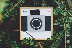 Brand P2 pinhole camera. It has a 40mm focal length and an aperture of f/160. It uses photographic paper and can produce 9x9 cm images.