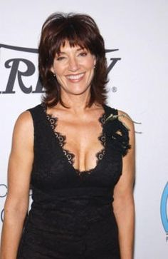 Katey Sagal medium layered hair style. Katey Sagal has a medium cut that is very layered, and features face framing angles that can be flipped back or under.     Short, choppy bangs offer a great cover for high foreheads.    The crown area is also heavily layered and offers height and bounce for this look.