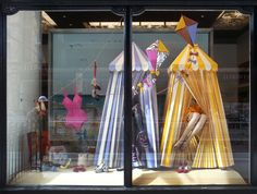 By Makerie.  These scenes were created under Zoe Bradley for Christian Louboutins Summer 2010 collection at their London flagship store. Every piece was created from paper and the scenes, which included paper sandcastles, bathing suits and kites, were on display for the entire summer season.