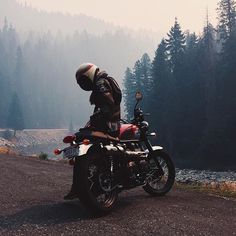 """dropmoto: """"I think we can all agree we'd rather be riding in Montana this weekend. @motomucci chillin' riverside on a Triumph Scrambler courtesy of @maverickboss. #dropmoto #triumphamerica #triumph #scrambler #bonneville #tracker """""""