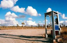 Situated in the middle of the Mojave desert, over a dozen miles from the nearest pavement, a lone phone booth sat along a dirt road, just waiting to become an international sensation.