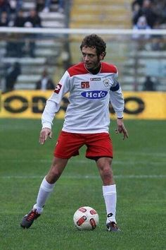 The doctor playing soccer.