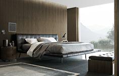 Dormitorio moderno con elegante cama de matrimonio con cabecero en piel por Gunni & Trentino Gunni & Trentino