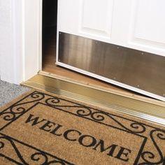 utilizar un felpudo de bienvenida en la entrada