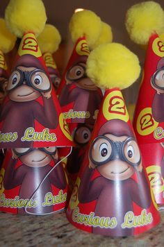 curious george party hats! OMG we need to fine these for Julia! @elise W.