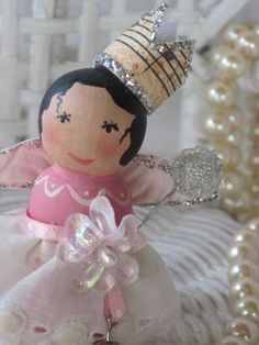 Spool dolly created by me, wings, lace, and of course a crown!
