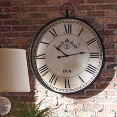 Augustina - Antique Black - Wall Clock by Signature Design by Ashley. Get your Augustina - Antique Black - Wall Clock at American Furniture, Brooklyn Park MN furniture store. Color Bordo, Oversized Clocks, Decorative Corbels, Metal Clock, H & M Home, Large Clock, Creative Walls, Antique Stores, At Home Store