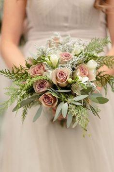 Winter wedding bouquet idea - blush pink roses, ivory freesia, cedar leaves, and dusty miller {Arte De Vie}