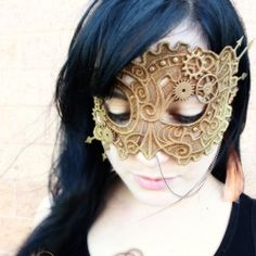 Stitch a freestanding lace mask and then steampunk it to perfection with scrapbook charms & spraypaint.