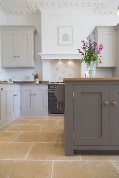 Farrow and Ball Mole's Breath (on island) and Purbeck Stone on perimeter cabinets.