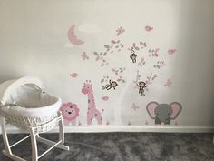 Enchanted Interiors Premium Self Adhesive Fabric Nursery Wall Decals Featuring our lion, elephant and giraffe jungle wall stickers in pink, grey and white