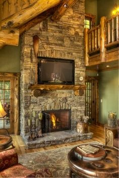 Beautiful Log Home!!! Bebe'!!! Love this fireplace of stone!!!