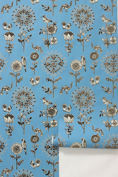 """""""Flora and Fauna"""" wallpaper; blue and interesting, a great accent wall."""